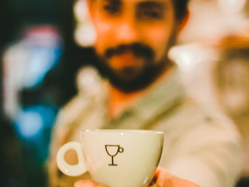 focus-photography-of-man-holding-ceramic-teacup-733761